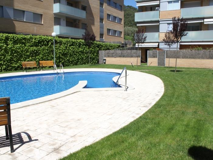 apartment pool garden in tossa - tossa de mar